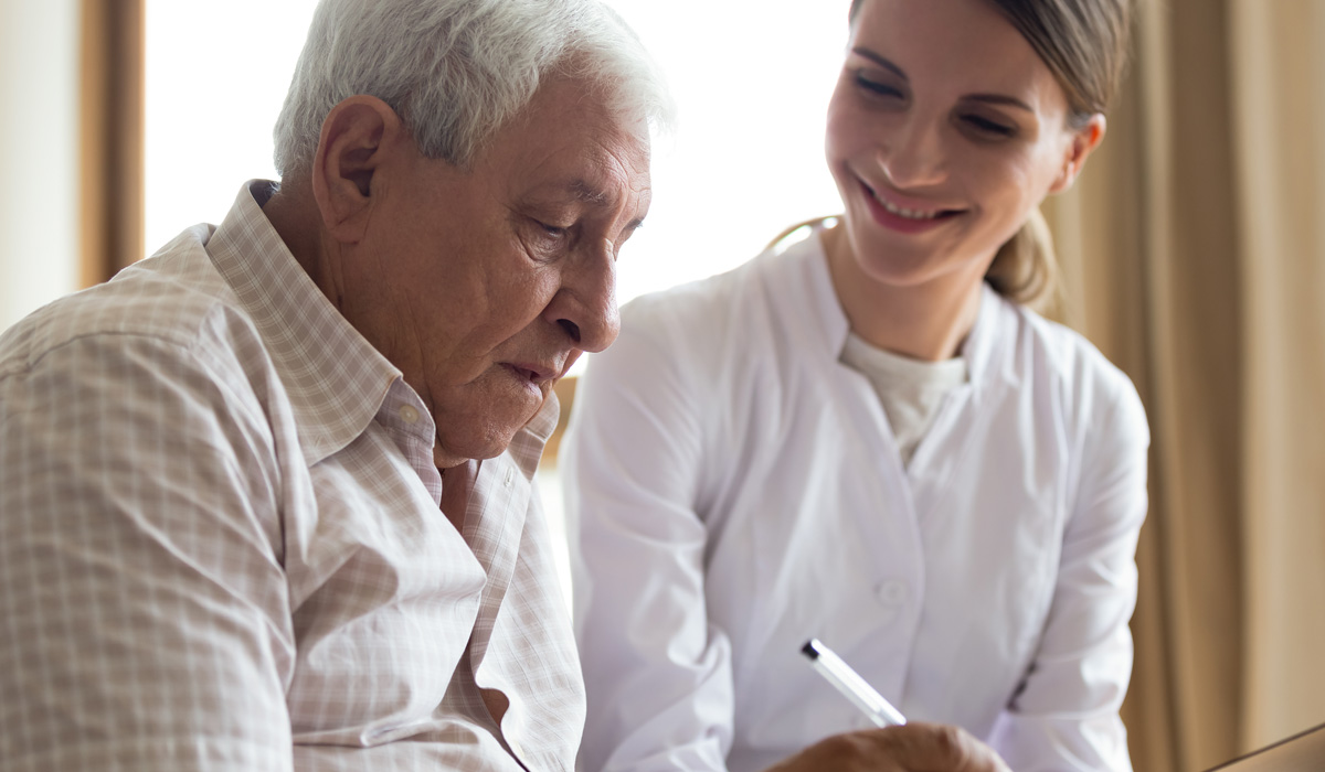 carer-helping-patient-with-paperwork